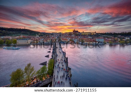 sunset over Charles Bridge and Prague Castle, Czech Republic - stock photo