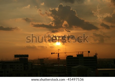Sunset over city buildings, Bangkok, Thailand.