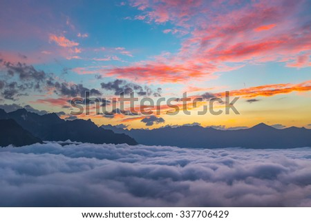 Sunset over cloudy walley at Caucasus mountains - stock photo