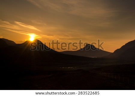 Sunset over Coigach and the unmistakeable Stac Pollaidh, Scottish Highlands.