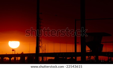 Sunset over docklabds in Melbourne, Australia - stock photo