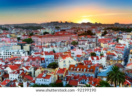 Sunset over downtown Lisbon (Portugal), as seen from Alfama - stock photo