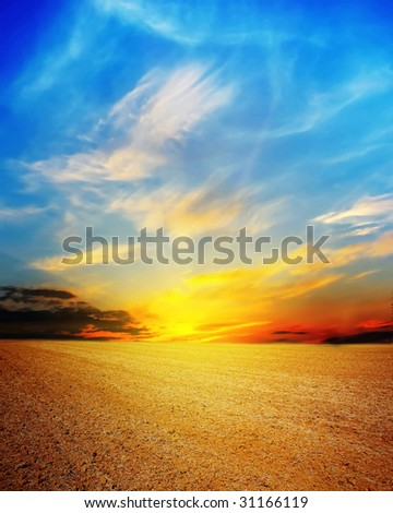 Sunset over dry land