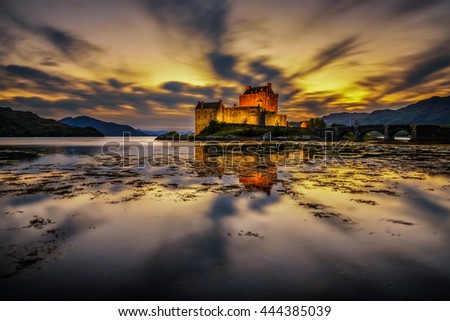 Sunset over Eilean Donan Castle, Scotland, United Kingdom. Long exposure. - stock photo