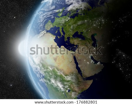 Sunset over Europe, Middle East and Africa region on planet Earth viewed from space with Sun and stars in the background. Elements of this image furnished by NASA. - stock photo