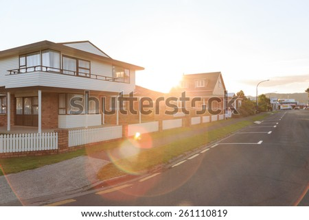 Sunset over family homes in a suburban area in Whitianga, New Zealand - stock photo