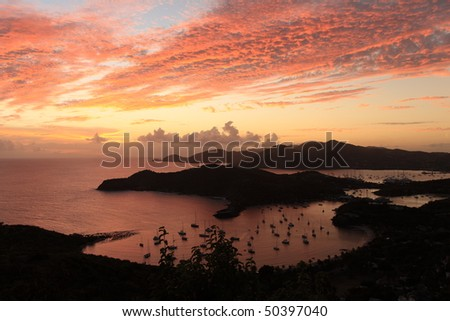 Sunset over famous English harbour, Antgiua in the Caribbean from a hill - stock photo