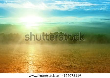 Sunset Over Fog Lake Sky Landscape Background - stock photo