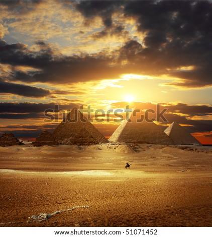 Sunset over Giza pyramids. Egypt - stock photo