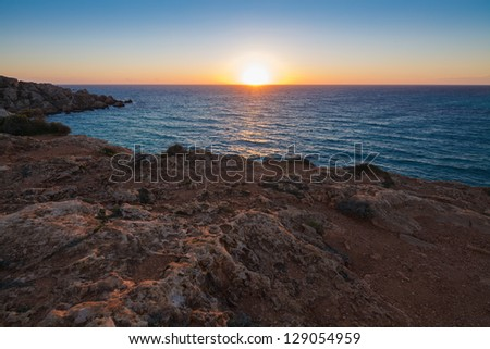 Sunset over Gnejna Bay, west side of the island, Malta - stock photo