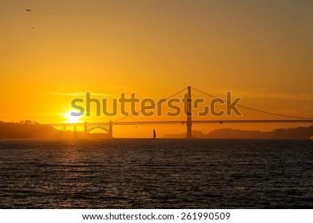 Sunset over Golden Gate Bridge - stock photo