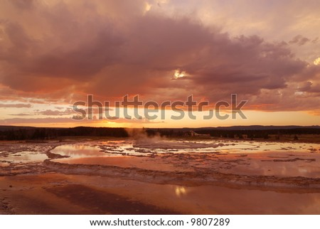 sunset over grand fountain pool at yellowstone national park - stock photo