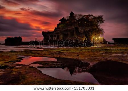 sunset over hindu temple Pura Tanah Lot, Bali, Indonesia - stock photo