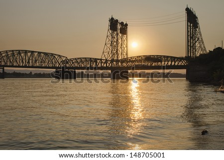 Sunset Over Interstate 5 Freeway Columbia Crossing Bridge Between Oregon and Washington State - stock photo
