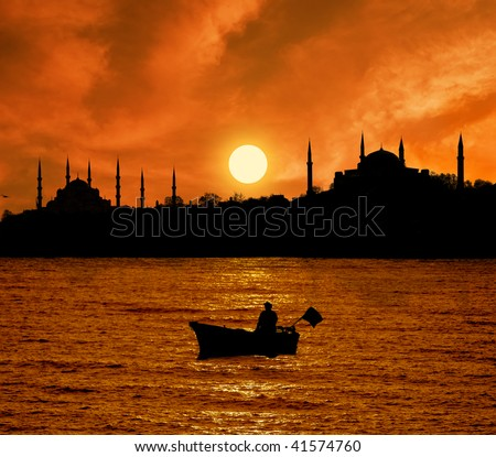 Sunset over Istanbul Silhouette and the fishing boat - stock photo