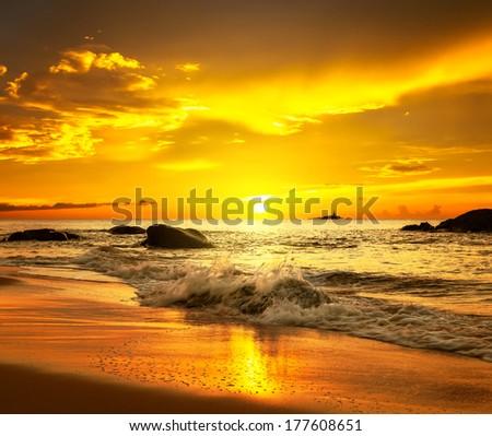 Sunset over  Khao Lak beach - stock photo