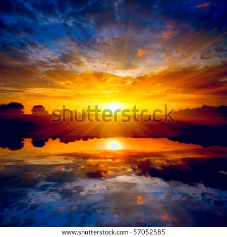 sunset over lake - stock photo
