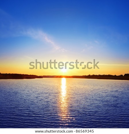 Sunset over lake. - stock photo