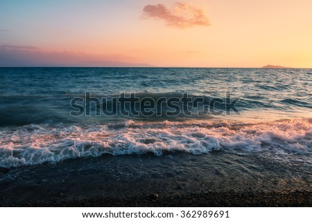 Sunset over lake alakol with clouds. Kazakhstan - stock photo