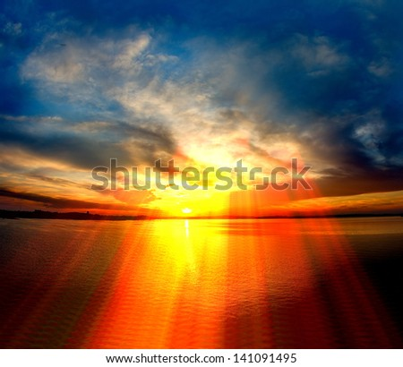 sunset over lake in Poland - stock photo