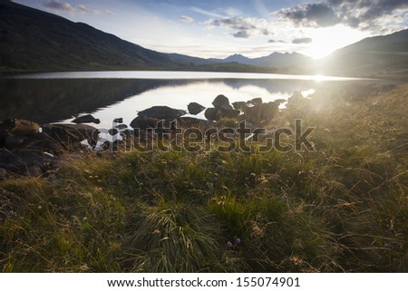 sunset over lake in snowdonia, north wales - stock photo