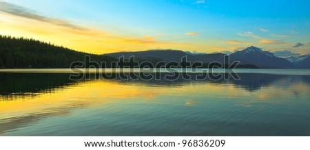 Sunset over Lake Mcdonald in Glacier National Park - stock photo