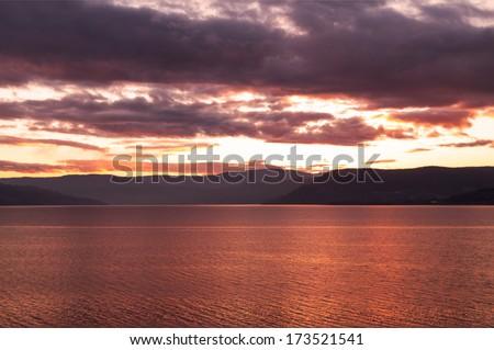 SunSet over Lake Okanagan over Okanagan Mountain Provincial Park - stock photo