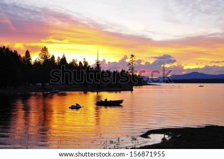 Sunset over Lake Tahoe with moored boat - stock photo