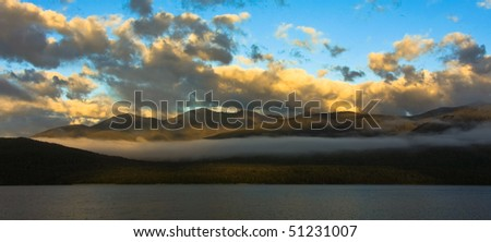 Sunset over Lake Te Anau, New Zealand South Island. - stock photo
