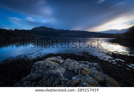 Sunset over Loch Sunart in the Scottish Highlands. - stock photo