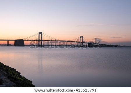 Sunset over Long Island Sound and Throgs Neck Bridge in New York City. - stock photo