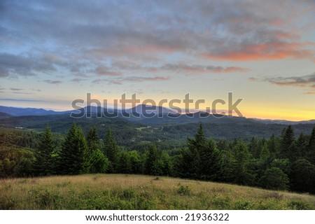 Sunset over Marys Peak in the Coast Range of Oregon - stock photo