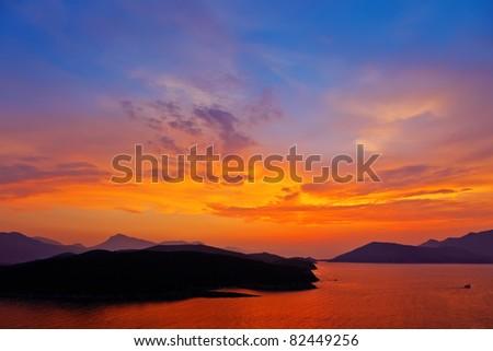 Sunset over mediterranean sea - stock photo