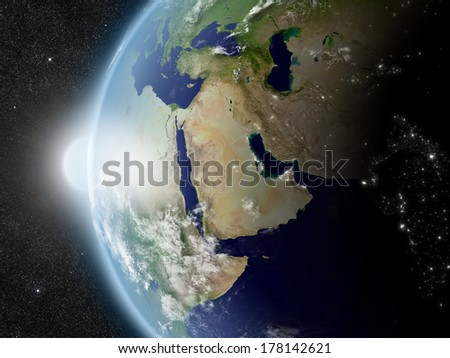 Sunset over Middle East region on planet Earth viewed from space with Sun and stars in the background. Elements of this image furnished by NASA. - stock photo