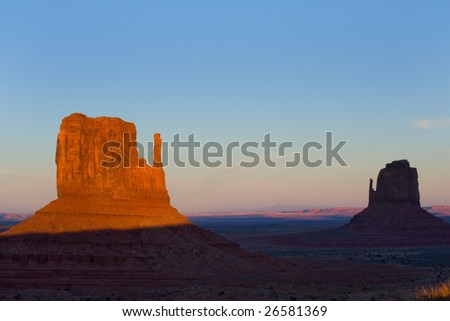 Sunset over Mittens in Monument Valley tribal park, Navajo reservation