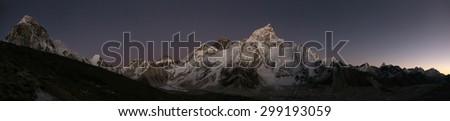 Sunset over Mount Everest (8,848 m) and Mount Nuptse (7,861 m) in Khumbu region, Himalayas, Nepal. - stock photo