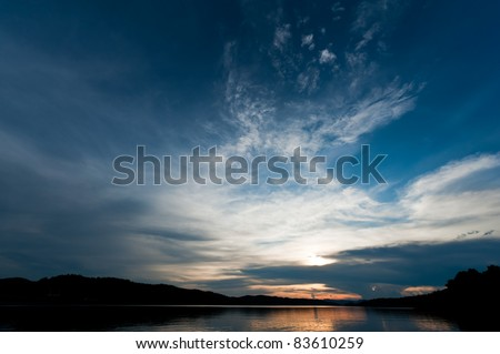 sunset over mountain and lake - stock photo