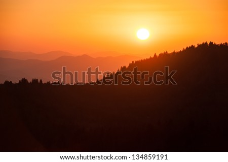 Sunset Over Mountain Ridge - stock photo