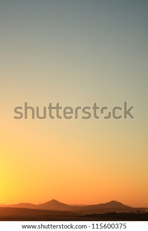 sunset over mountains - stock photo