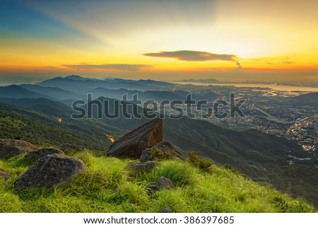 Sunset over new territories in hong kong as viewed atop Tai Mo Shan - stock photo