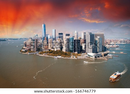 Sunset over New York skyline. Beautiful aerial view from helicopter. - stock photo