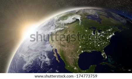 Sunset over North America region on planet Earth viewed from space with Sun and stars in the background. Elements of this image furnished by NASA. - stock photo