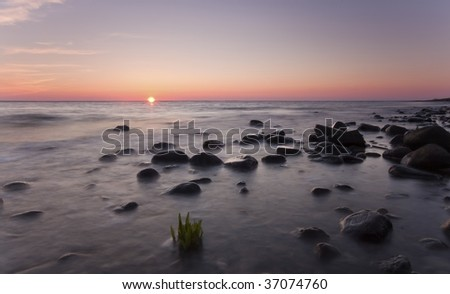 Sunset over ocean, wide angle photo. - stock photo