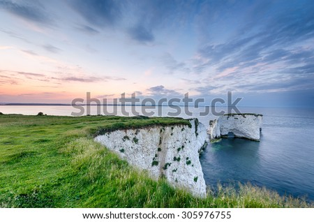 Sunset over Old Harry Rocks near Swanage and the start of the Jurassic Coast in Dorset - stock photo