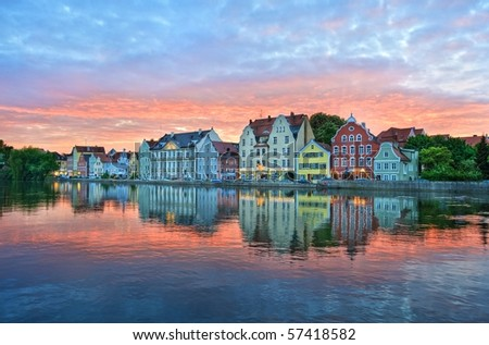 Sunset over old town of Landshut by Munich, a colorful gothic german town on Isar river, Germany