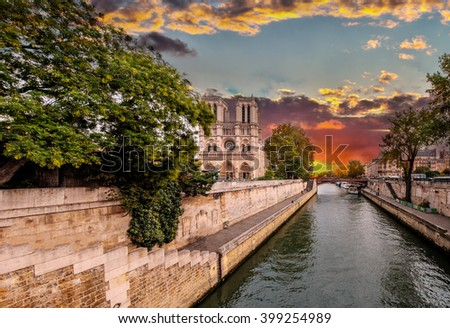 Sunset over Paris - Notre Dame - Seine, France in a beautifull autumn day. Seine river in the foreground, cathedral in the background./Paris - Notre Dame - Seine, France - stock photo
