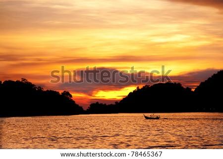 sunset over patai cenang beach, lankawie, malaysia - stock photo