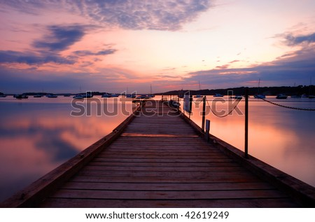 Sunset over peaceful Poole Harbour and its islands. - stock photo