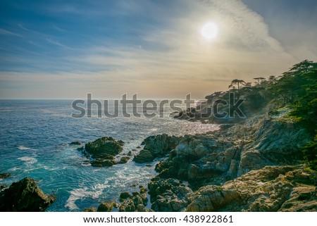 Sunset over Pebble Beach near Carmel, California, USA.  Pacific Ocean on the California Coastline - stock photo