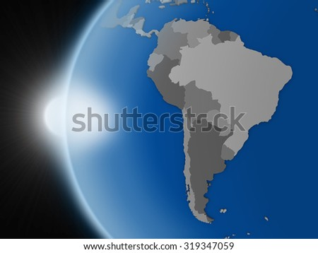 Sunset over planet Earth as if seen from space but with political borders aimed at south american continent - stock photo
